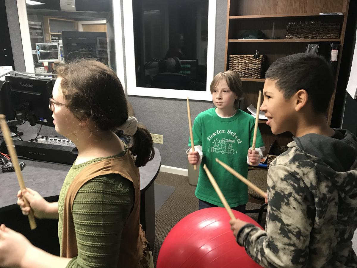 Newton students drumming on WHAI