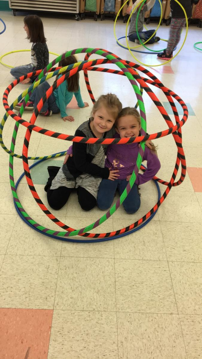 2 Newton students playing with hoola hoops 2