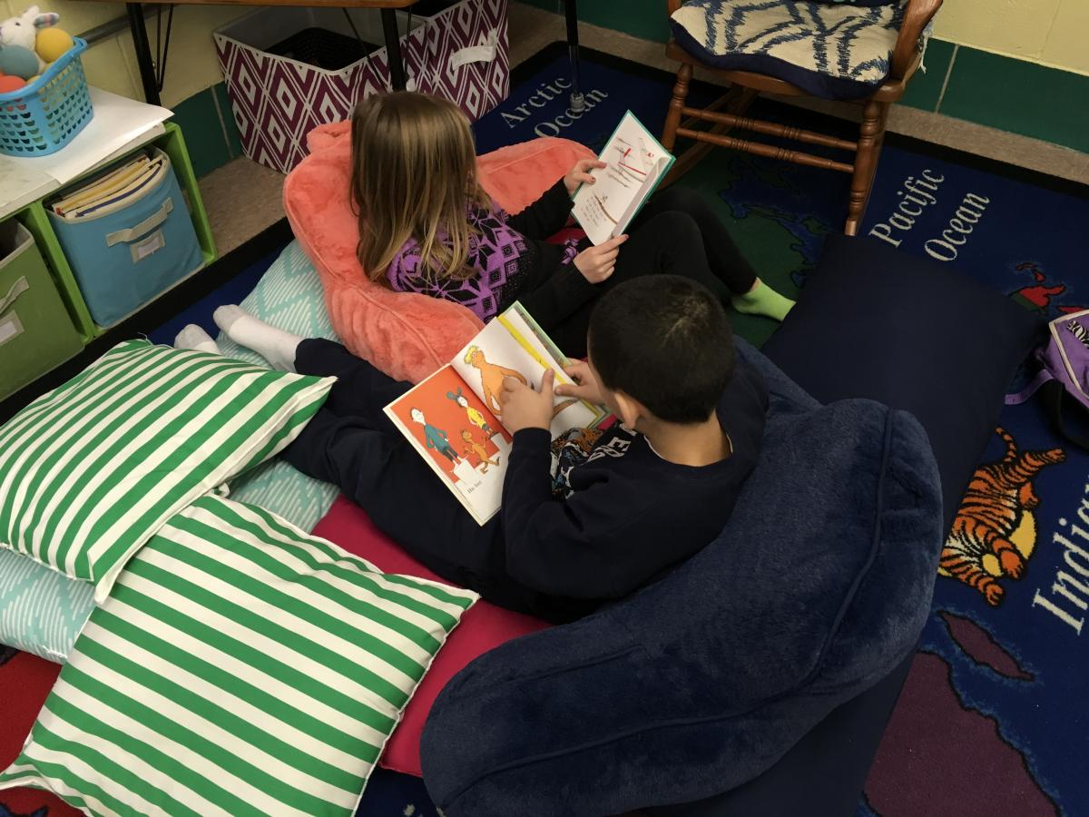 Newton students reading Dr. Suess books