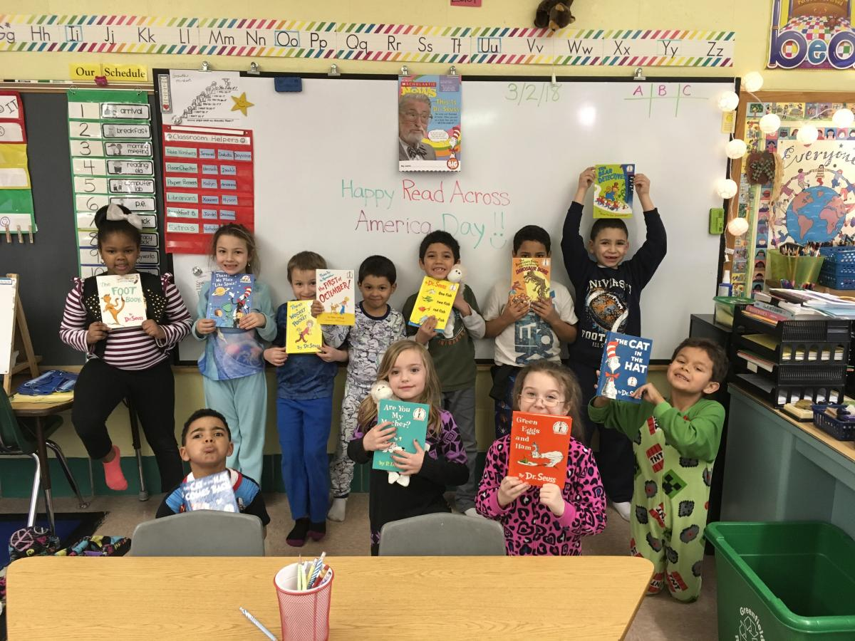 Newton students holding Dr. Seuss books