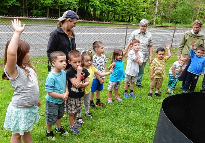 AEL students learning about composting